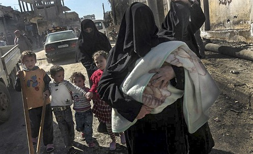 Women and children fleeing violence in Sermin, Syria