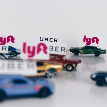 Cars with Lyft and Uber signs
