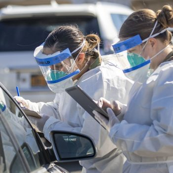 Health workers in protective gear at a coroanvirus testing site