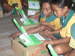 Children using computers provided by One Laptop per Child, a non-profit that creates low-cost laptops for students in developing countries.